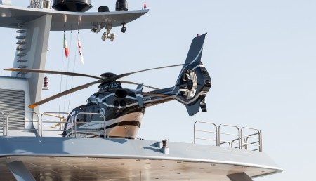 Luxury yacht with helicopter onboard